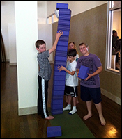 Boys at Equinox building an obstacle course